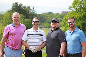 Participants in Charity Golf Tournament
