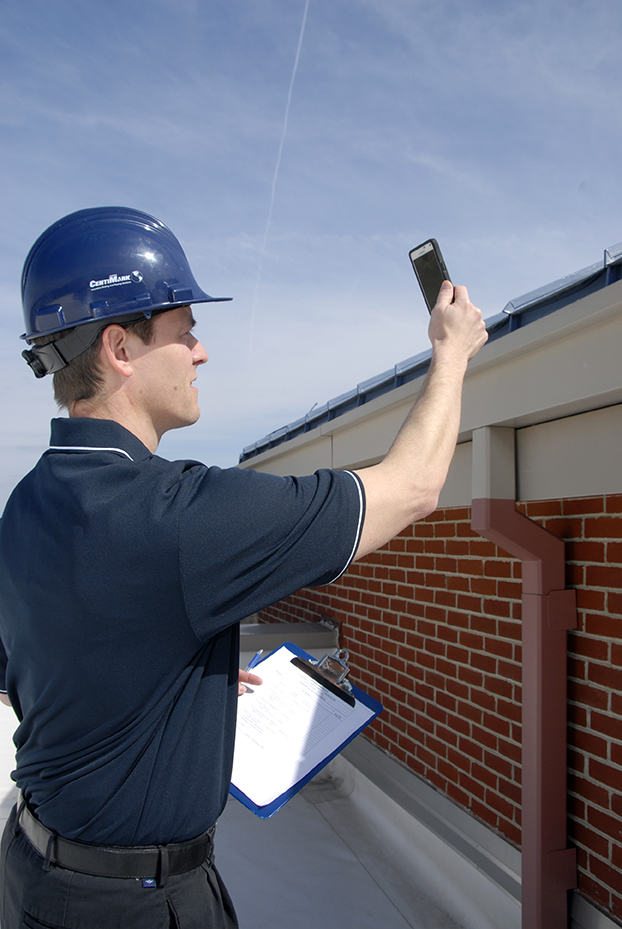 CentiMark Roofer Using Technology to Help Conduct Roof Inspection
