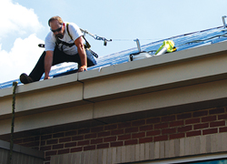 CentiMark Roofer Working on Roof