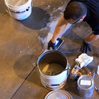Contractor Using QuestMark's Concrete Flooring Patch